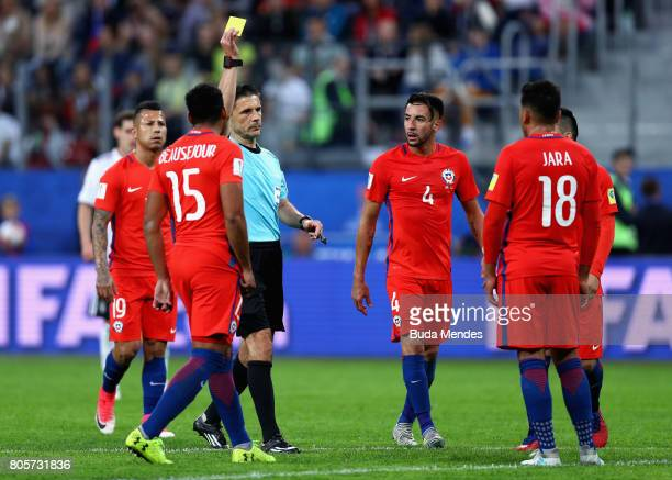Gonzalo Jara of Chile is shown a yellow card by Referee Milorad Mazic during the FIFA Confederations Cup Russia 2017 Final between Chile and Germany...