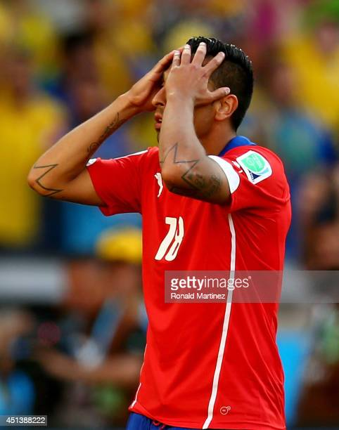 Gonzalo Jara of Chile reacts after being defeated by Brazil in a penalty shootout during the 2014 FIFA World Cup Brazil round of 16 match between...