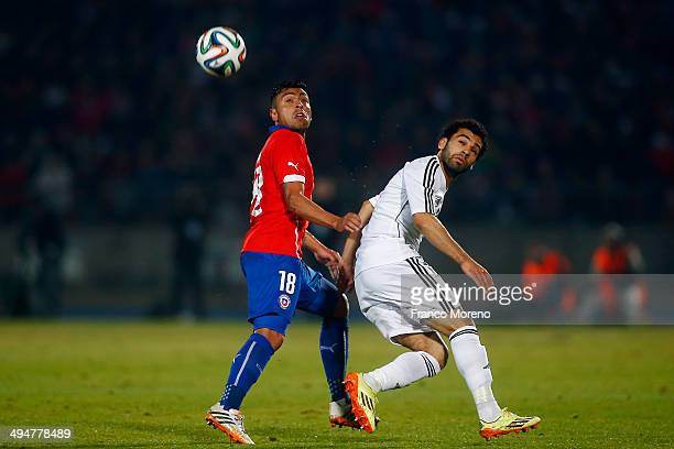 Gonzalo Jara of Chile struggles for the ball with Mohamed Salah of Egypt during the international friendly match between Chile and Egypt at Nacional...