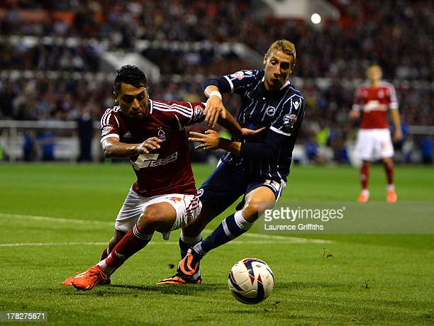 Gonzalo Jara of Nottingham Forest battles with Lee Martin of Millwall during the Capital One Cup Second Round match between Nottingham Forest and...