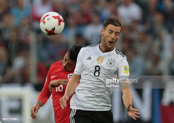 Gonzalo Jara of the Chile national football team and Leon Goretzka of the Germanyl national football team vie for the ball during the 2017 FIFA...