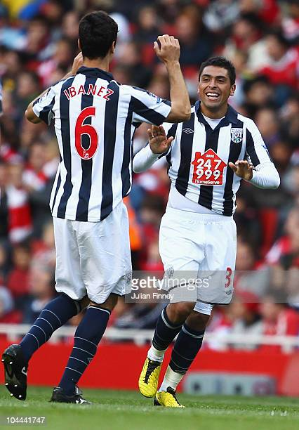 Gonzalo Jara of West Bromwich Albion celebrates with Pablo Ibanez as he scores their second goal during the Barclays Premier League match between...