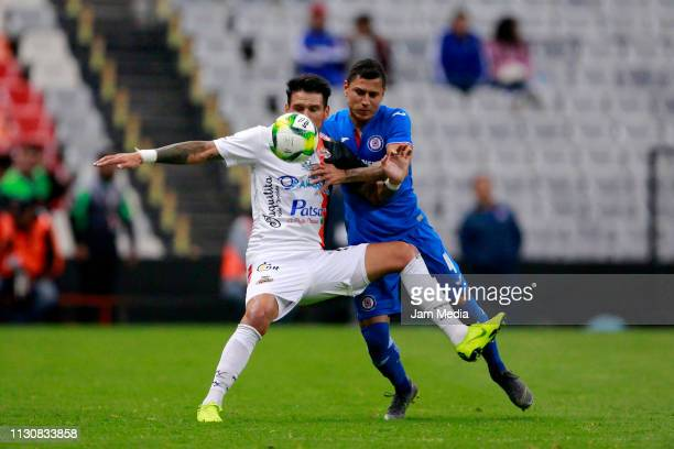 Gonzalo Malan of Alebrijes fights for the ball with Julio Dominguez of Cruz Azul during a match between Cruz Azul and Alebrijes as part of the Copa...