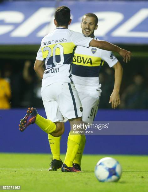 Gonzalo Maroni of Boca Juniors celebrates with teammate Dario Benedetto after scoring the third goal of his team during a match between Boca Juniors...