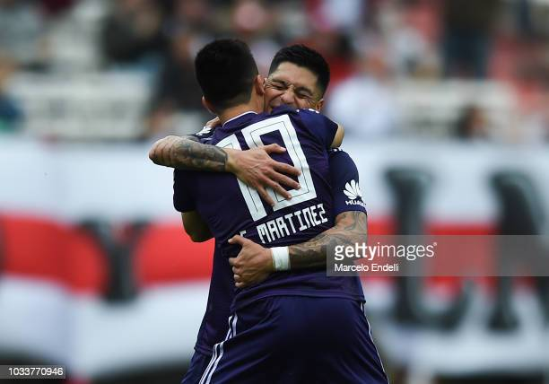Gonzalo Martinez of River Plate celebrates with teammate Enzo Perez after scoring the fourth goal of his team during a match between River Plate and...