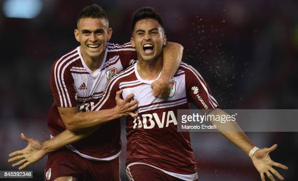 Gonzalo Martinez of River Plate celebrates with teammate Rafael Santos Borre after scoring the second goal of his team during a match between River...