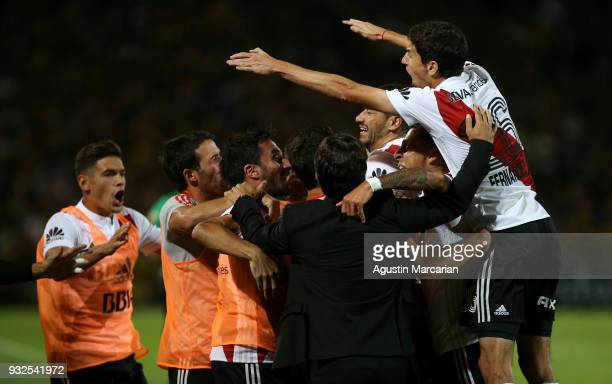 Gonzalo Martinez of River Plate celebrates with teammates after scoring the first goal of his team during the Supercopa Argentina 2018 between River...