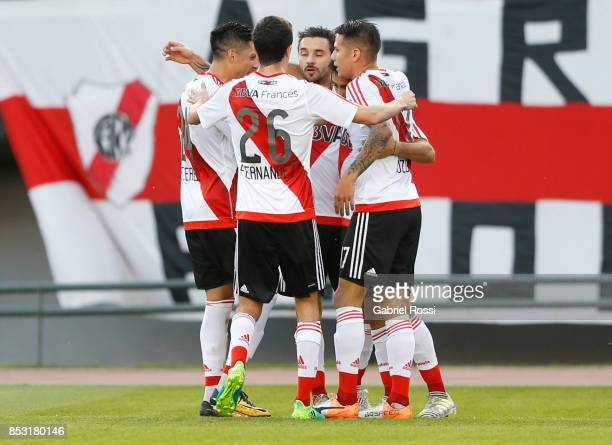Gonzalo Martinez of River Plate celebrates with teammates Ignacio Scocco Carlos Auzqui and Ignacio Fernandez after scoring the first goal of his team...