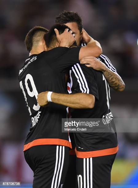 Gonzalo Martinez of River Plate celebrates with teammates Rafael Santos Borré and Ignacio Scocco after scoring the second goal of his team during a...