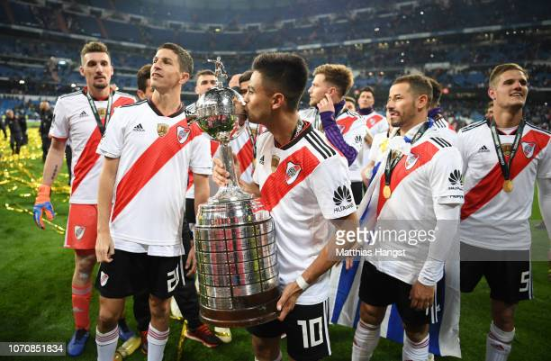 Gonzalo Martinez of River Plate celebrates with the Copa Libertadores Trophy following his sides victory in the second leg of the final match of Copa...