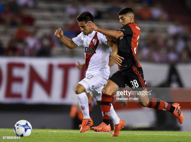 Gonzalo Martinez of River Plate fights for ball with Brian Rivero of Newells Old Boys during a match between River and Newell's Old Boys as part of...