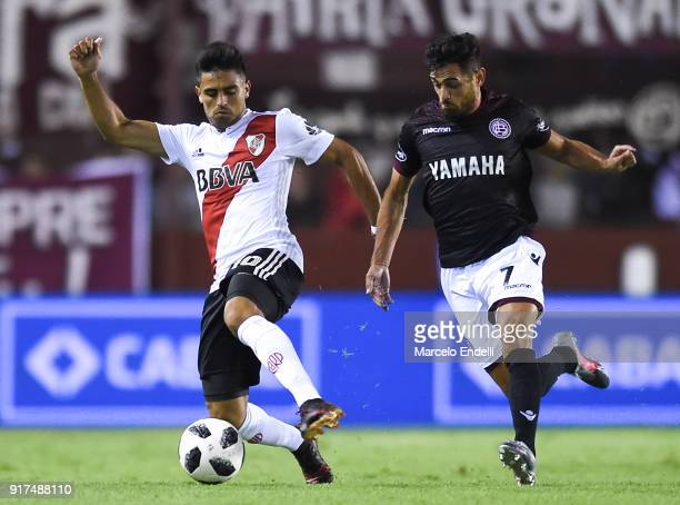 Gonzalo Martinez of River Plate fights for ball with Lautaro Acosta of Lanus during a match between Lanus and River Plate as part of the Superliga...