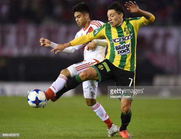 Gonzalo Martinez of River Plate fights for ball with Pablo Luguercio of Aldosivi during a match between River Plate and Aldosivi as part of Torneo...