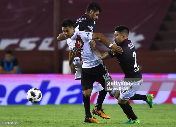 Gonzalo Martinez of River Plate fights for ball with Roman Martinez and Gabriel Carrasco of Lanus during a match between Lanus and River Plate as...