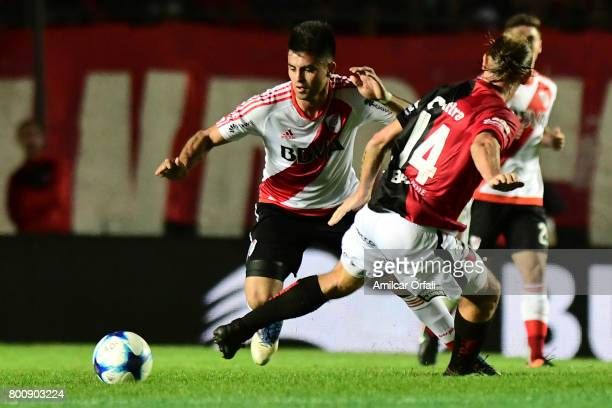 Gonzalo Martinez of River Plate fights for the ball with Adrian Bastia of Colon during a match between Colon and River Plate as part of Torneo...