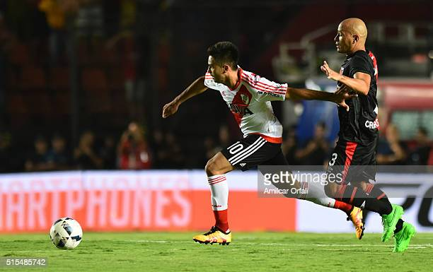 Gonzalo Martinez of River Plate fights for the ball with Clemente Rodriguez of Colon during a match between Colon and River Plate as part of Torneo...