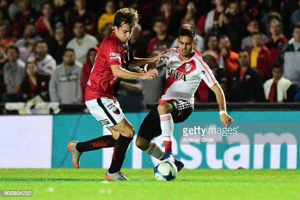 Gonzalo Martinez of River Plate fights for the ball with Cristian Bernardi of Colon during a match between Colon and River Plate as part of Torneo...