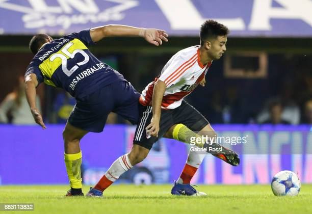 Gonzalo Martinez of River Plate fights for the ball with Juan Manuel Insaurralde of Boca Juniors during a match between Boca Juniors and River Plate...