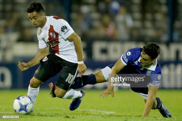 Gonzalo Martinez of River Plate fights for the ball with Lorenzo Faravelli of Gimnasia y Esgrima La Plata during a match between Gimnasia y Esgrima...