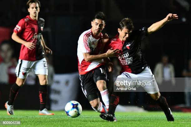 Gonzalo Martinez of River Plate fights for the ball with Lucas Ceballos of Colon during a match between Colon and River Plate as part of Torneo...
