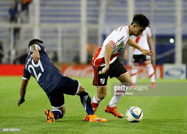 Gonzalo Martinez of River Plate fights for the ball with Lucas Romero of Velez Sarsfield during a match between Velez Sarsfield and River Plate as...