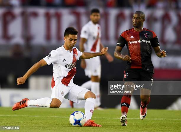 Gonzalo Martinez of River Plate fights for the ball with Luis Leal of Newell's Old Boys during a match between River and Newell's Old Boys as part of...
