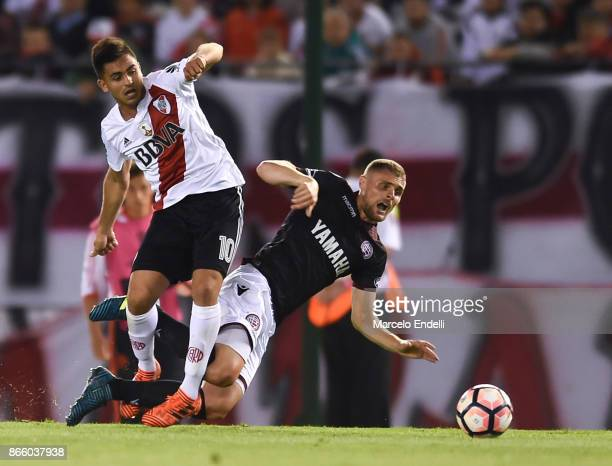 Gonzalo Martinez of River Plate fights for the ball with Nicolas Pasquini of Lanus during a first leg match between River Plate and Lanus as part of...