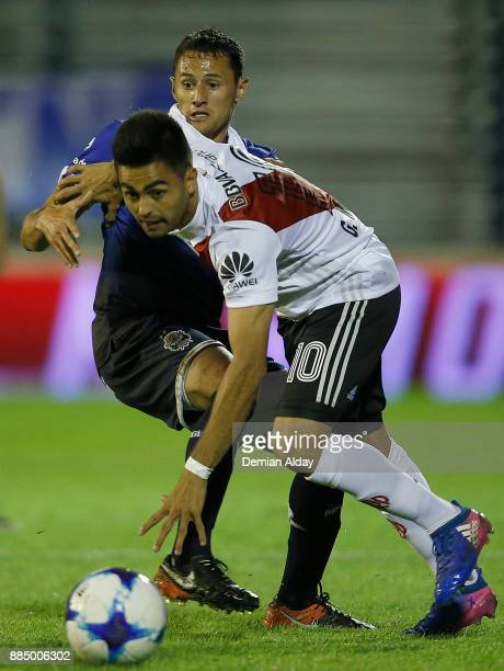 Gonzalo Martinez of River Plate fights for the ball with Nicolas Dibble of Gimnasia y Esgrima during a match between Gimnasia y Esgrima La Plata and...