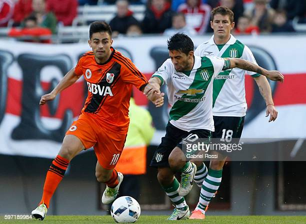 Gonzalo Martinez of River Plate fights for the ball with Walter Erviti of Banfield during a match between River Plate and Banfield as part of first...