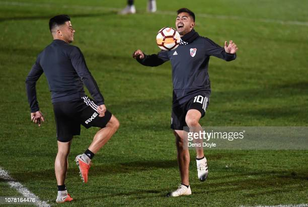 Gonzalo Martinez of River Plate jokes with teammate Jorge Moreira during a training session at Ciudad Real Madrid training grounds ahead of the...