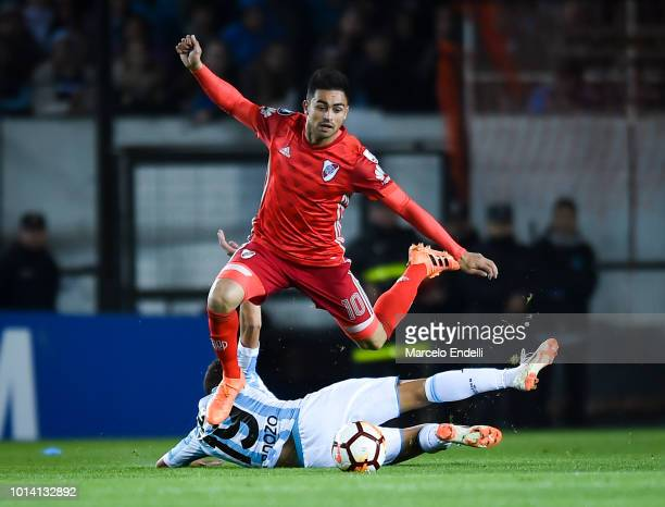 Gonzalo Martinez of River Plate jumps over Neri Cardozo of Racing Club during a round of sixteen first leg match between River Plate and Racing Club...