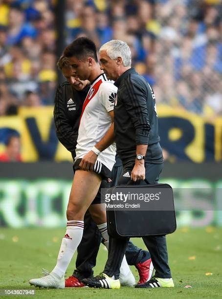 Gonzalo Martinez of River Plate leaves the field injured during a match between Boca Juniors and River Plate as part of Superliga 2018/19 at Estadio...