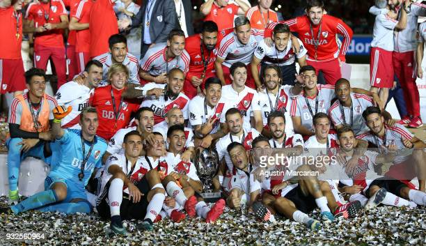 Gonzalo Martinez Rodrigo Mora of River Plate and teammates celebrate with the Supercopa Argentina 2018 throphy after winning the final match against...