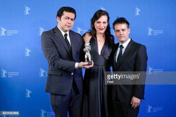 Gonzalo Maza and Sebastian Lelio pose with actress Daniela Vega and their Silver Bear for Best Screenplay for the film Una Mujer Fantastica backstage...