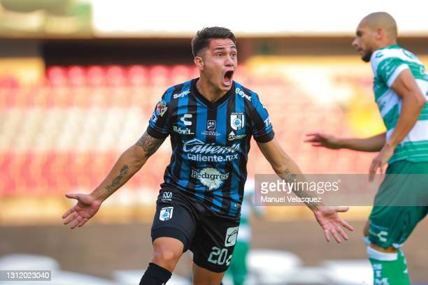 Gonzalo Montes of Querétaro celebrates after scoring the first goal of his team during the 14th round match between Queretaro and Santos Laguna as...
