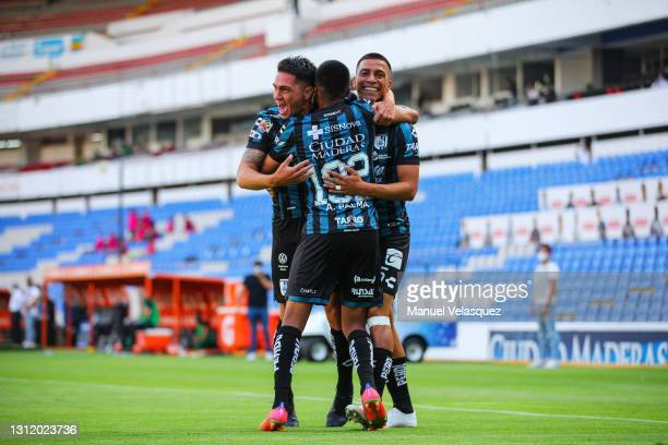 Gonzalo Montes of Querétaro celebrates with teammates after scoring the first goal of his team during the 14th round match between Queretaro and...