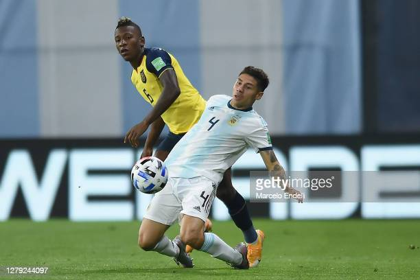 Gonzalo Montiel of Argentina fights for the ball with Pervis Estupiñán of Ecuador during a match between Argentina and Ecuador as part of South...