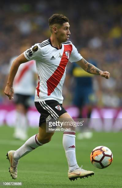 Gonzalo Montiel of River Plate drives the ball during the first leg match between Boca Juniors and River Plate as part of the Finals of Copa CONMEBOL...
