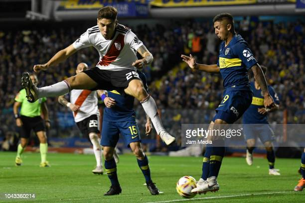 Gonzalo Montiel of River Plate fights for the ball with Agustin Almendra of Boca Juniors during a match between Boca Juniors and River Plate as part...