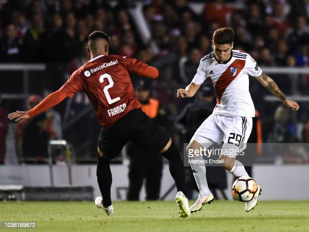 Gonzalo Montiel of River Plate fights for the ball with Alan Franco of Independiente during a quarter final first leg match between Independiente and...