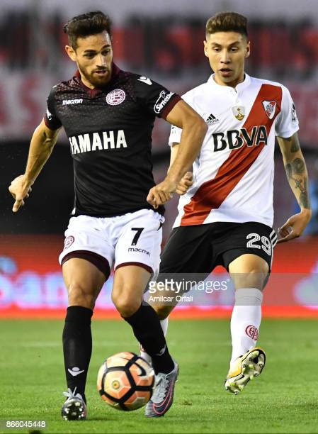 Gonzalo Montiel of River Plate fights for the ball with Lautaro Acosta of Lanus during a first leg match between River Plate and Lanus as part of...