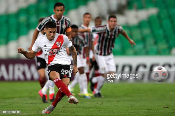 Gonzalo Montiel of River Plate kicks a penalty to score the first goal of his team during a match between Fluminense and River Plate as part of group...