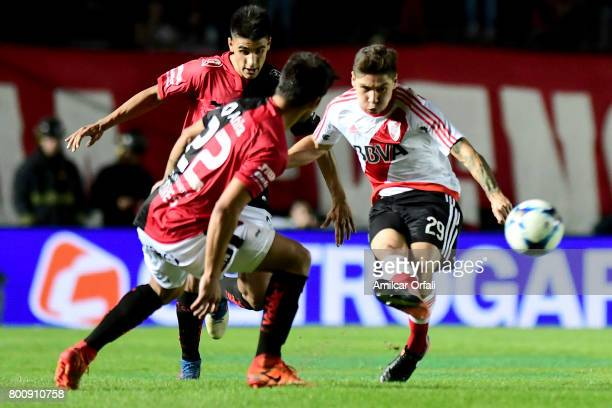 Gonzalo Montiel of River Plate kicks the ball while followed by Ivan Torres of Colon during a match between Colon and River Plate as part of Torneo...