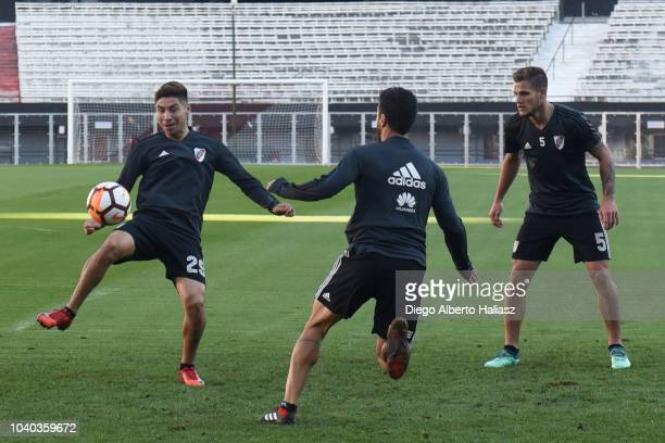 Gonzalo Montiel of River Plate plays the ball as teammates Bruno Zuculini and Ignacio Scocco look during a training session at Estadio Monumental...