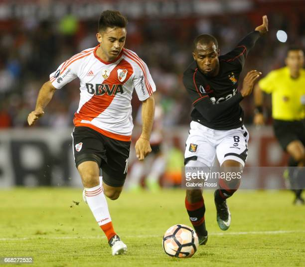 Gonzalo Nicolas Martinez of River Plate fights for the ball with Dawhling Leudo Cossio of Melgar during a match between River Plate and FBC Melgar as...