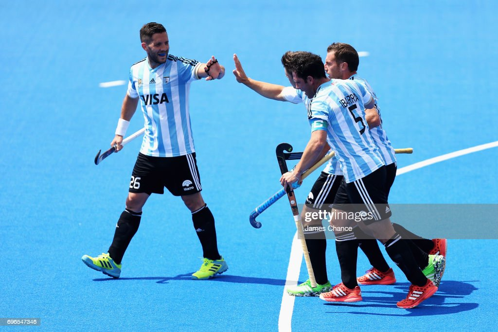 Gonzalo Peillat of Argentina (R/obscure) celebrates scoring with Agustin Mazzilli of Argentina (L) and his team mates during the Pool A match between Korea and Argentina on day one of Hero Hockey World League Semi-Final at Lee Valley Hockey and Tennis Centre on June 15, 2017 in London, England.