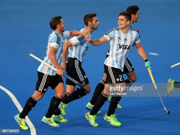 Gonzalo Peillat of Argentina celebrates with teammates after scoring the opening goal during the Pool A match between Argentina and China on day five...