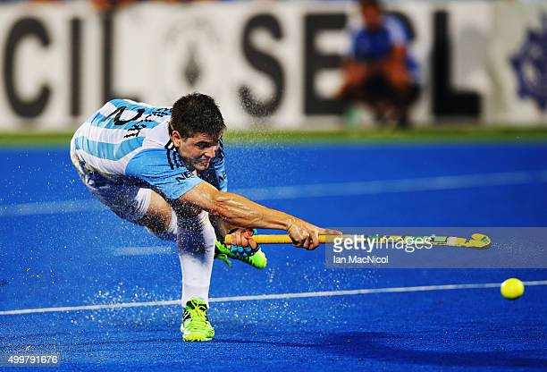 Gonzalo Peillat of Argentina strikes the ball during the match between Argentina and Belgium on day seven of The Hero Hockey League World Final at...