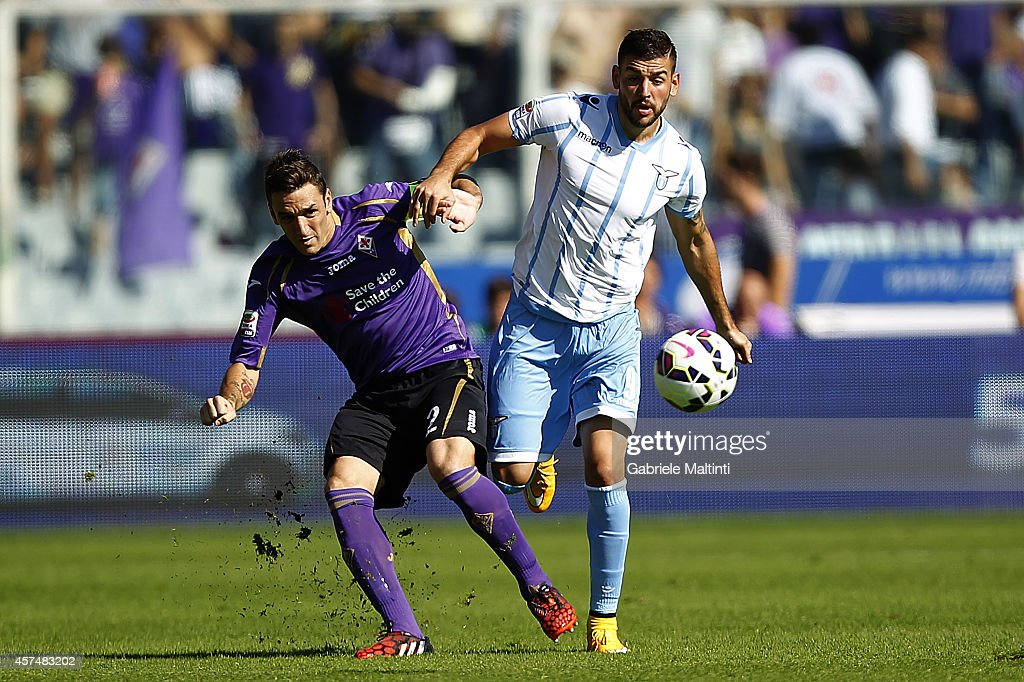 Gonzalo Rodriguez of ACF Fiorentina fights for the ball with Filip Djodjevic of SS Lazio during the Serie A match between ACF Fiorentina and SS Lazio at Stadio Artemio Franchi on October 19, 2014 in Florence, Italy.