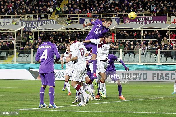 Gonzalo Rodriguez of ACF Fiorentina scores the opening goal during the Serie A match between ACF Fiorentina and AS Livorno Calcio at Stadio Artemio...